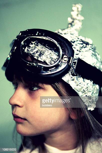 profile of child in tin foil hat