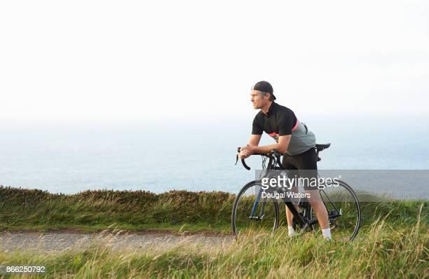 Profile of cyclist on coastal cycle path.