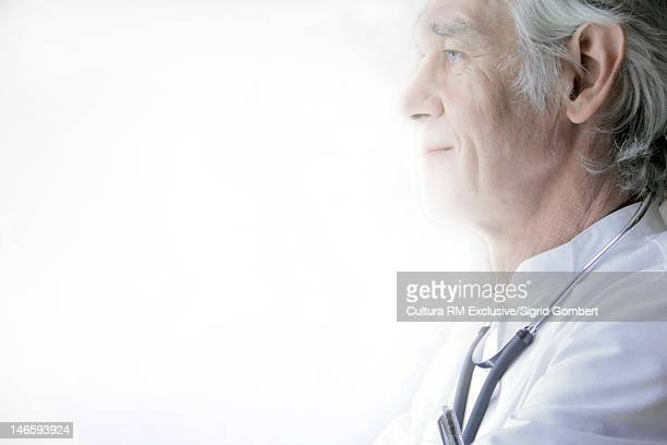 Profile of doctor wearing stethoscope