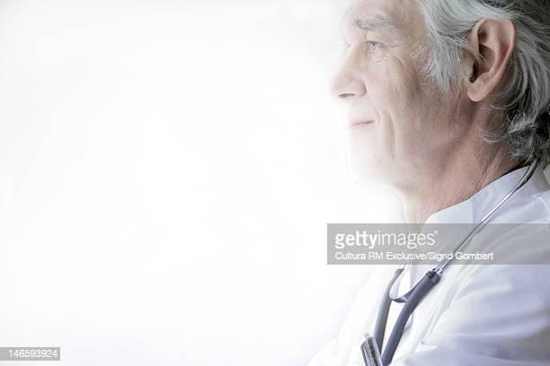 profile of doctor wearing stethoscope - sigrid gombert fotografías e imágenes de stock