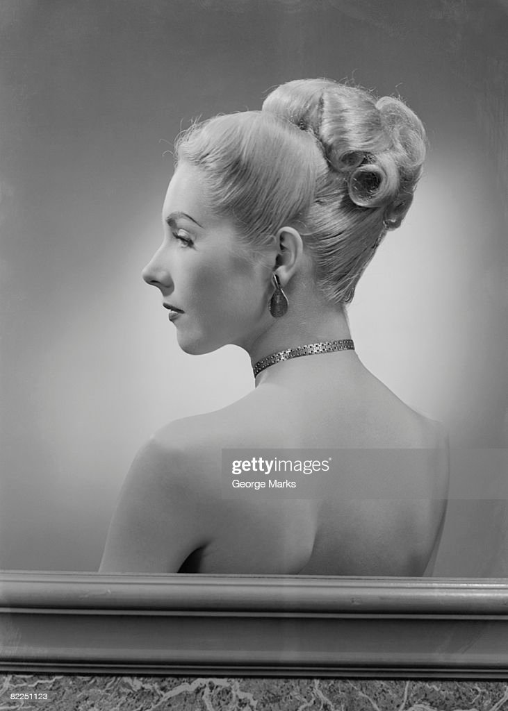 Profile of elegant mid adult woman, studio shot : Stock Photo