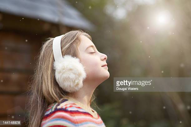 Profile of girl in winter setting with eyes closed