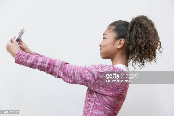 Profile of girl taking selfie
