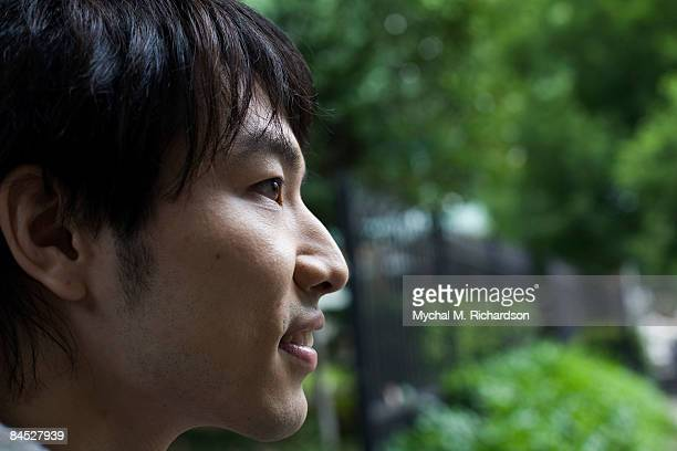 Profile of Japanese man outdoors