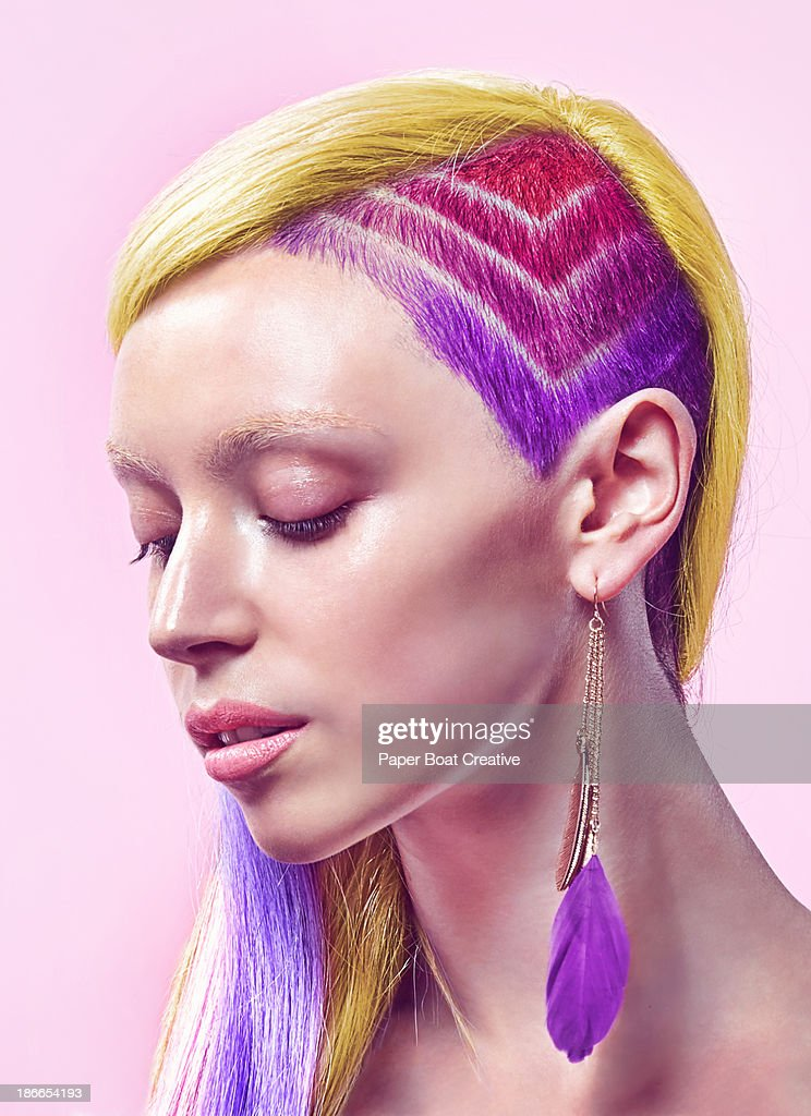 Profile of lady with rainbow undercut and dyed hai : Stock Photo