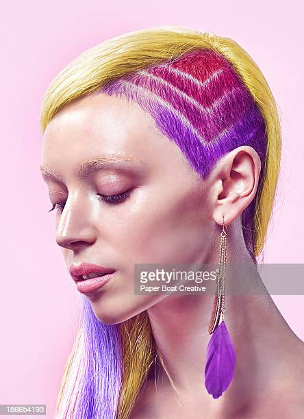 Profile of lady with rainbow undercut and dyed hai