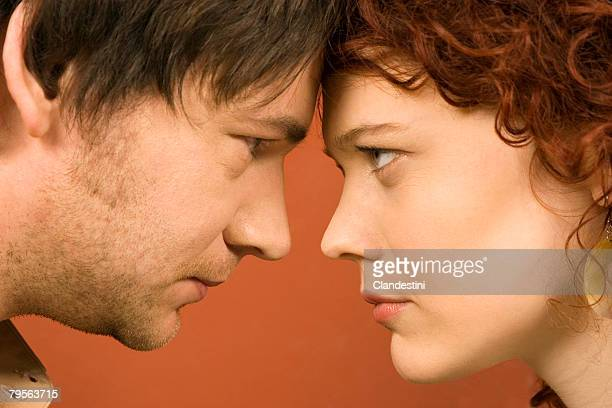 Man and woman looking at each other angrily