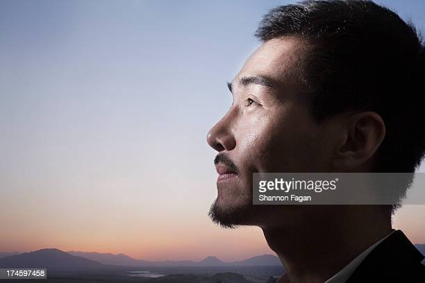 Profile of Man In Front of Sunset