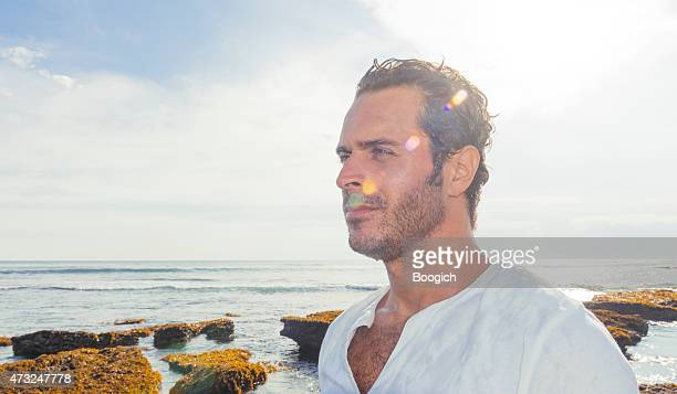 profile of man living in tropical bali indonesia travel destination - hairy chest stock photos and pictures