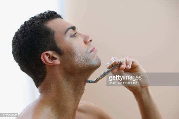 profile of man shaving - shaving stock pictures, royalty-free photos & images