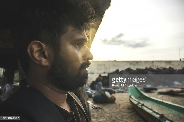 Profile Of Man With Beard Looking At View