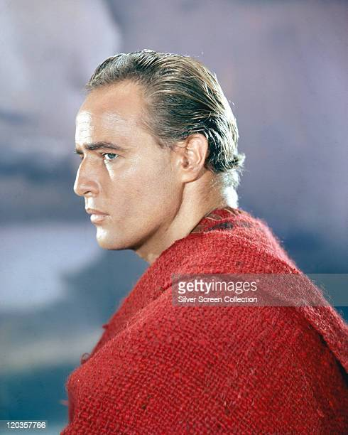 Profile of Marlon Brando US actor wearing a red poncho in a publicity portrait issued for the film 'OneEyed Jacks' 1961 The western directed by...