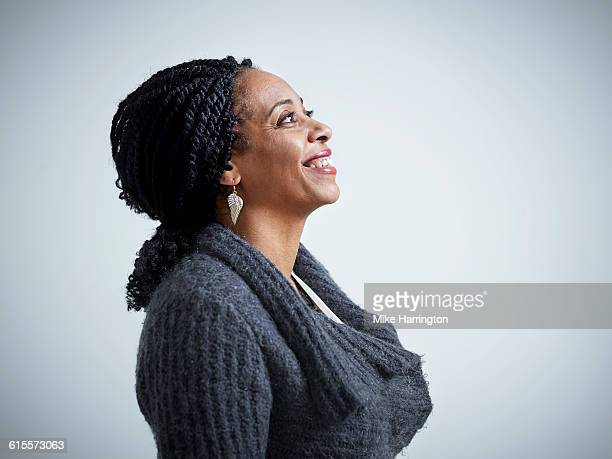 profile of mature female smiling - 45 49 years stock pictures, royalty-free photos & images
