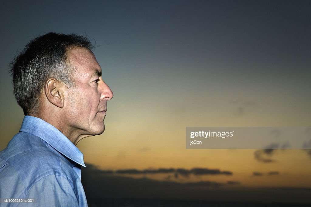 Profile of mature man, sunset in background : Foto stock