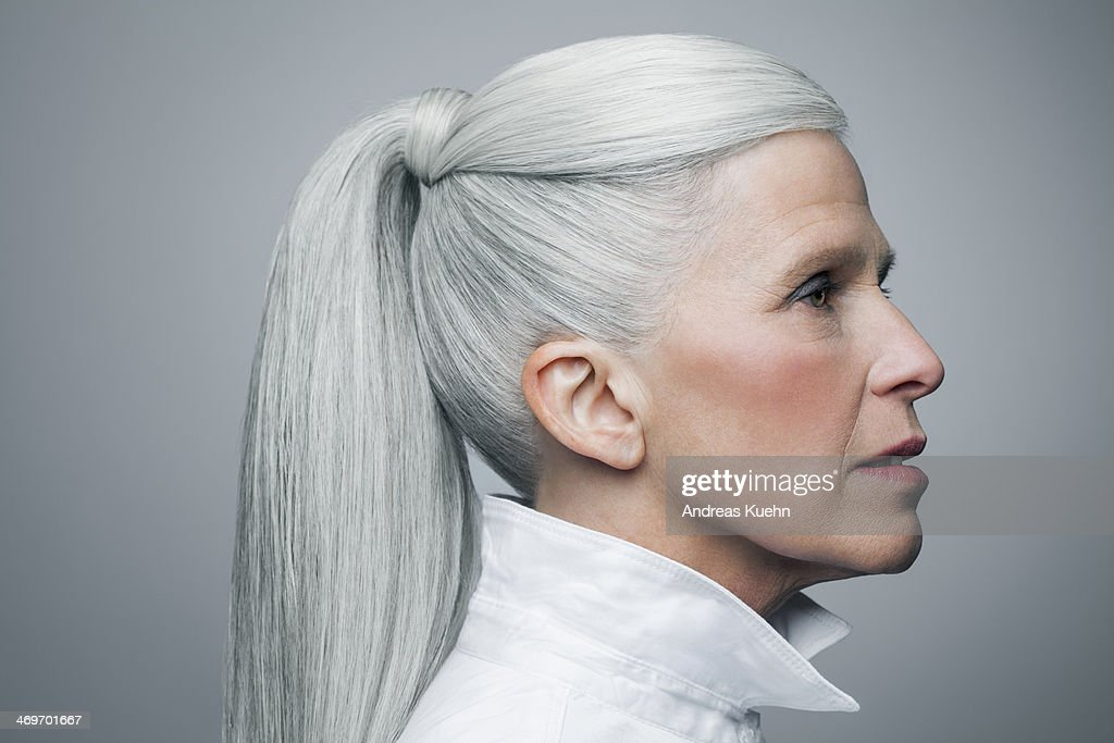 Profile of mature woman with grey hair, portrait. : Stock Photo