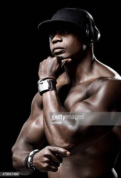 profile of muscled black male - black male bodybuilders stock photos and pictures