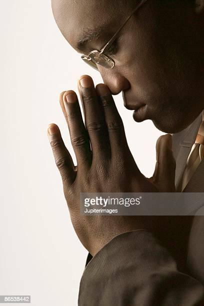 Profile of pensive businessman in eyeglasses