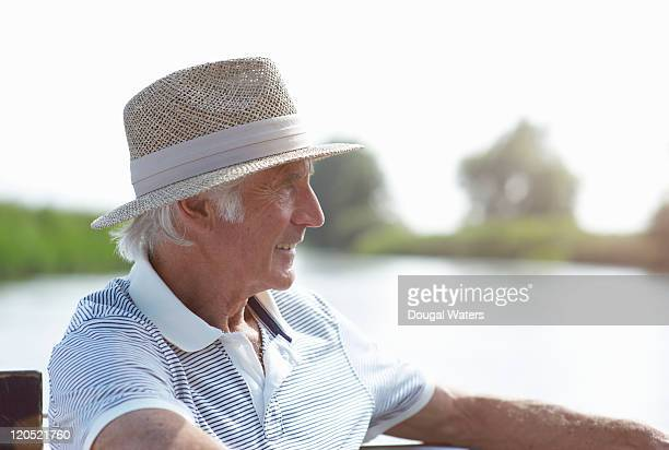 Profile of senior man by river.