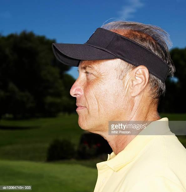 Profile of senior man wearing sun visor