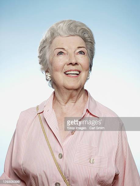 Profile of senior woman smiling and looking up
