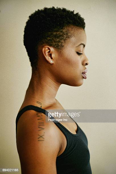 profile of serious black woman - shoulder stock pictures, royalty-free photos & images