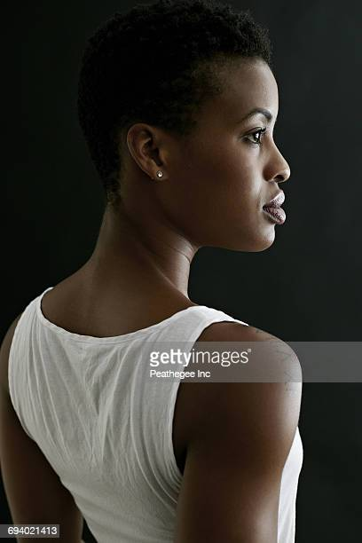 profile of serious black woman - tattoo shoulder stock photos and pictures