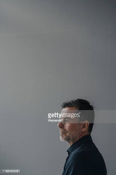 profile of serious mature businessman - grey hair stock pictures, royalty-free photos & images