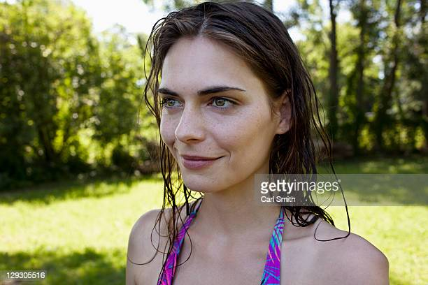 Profile of smiling girl with wet hair
