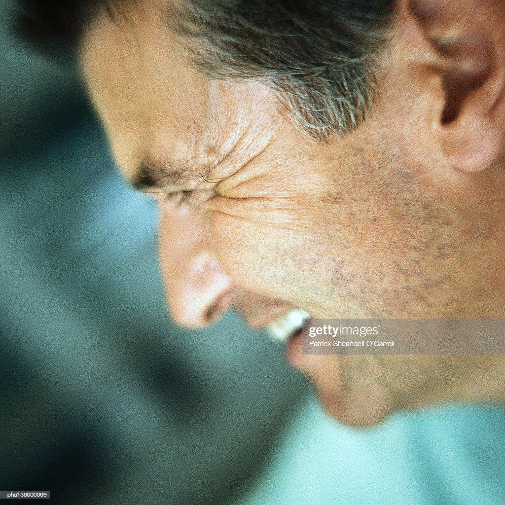 Profile of smiling man : Stock Photo