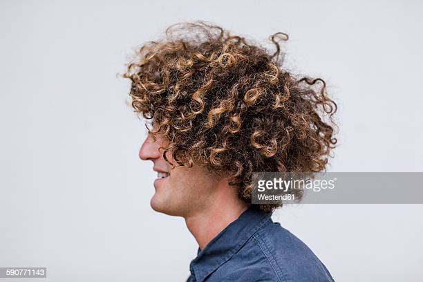 profile of smiling man with curly hair - profile stock pictures, royalty-free photos & images
