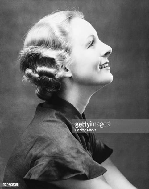 profile of smiling woman, (b&w), close-up, portrait - permed hair stock photos and pictures
