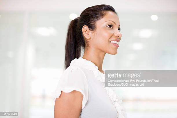 "profile of smiling woman - ""compassionate eye"" stock-fotos und bilder"