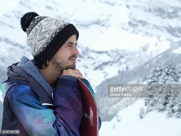 profile of snowboarder in the alps. - ニット帽 ストックフォトと画像