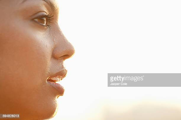 Profile of sweating Hispanic woman