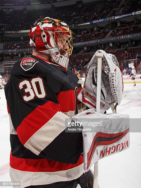 A profile of the throwback mask of Andrew Hammond of the Ottawa Senators during warmup prior to a game against the Nashville Predators at Canadian...
