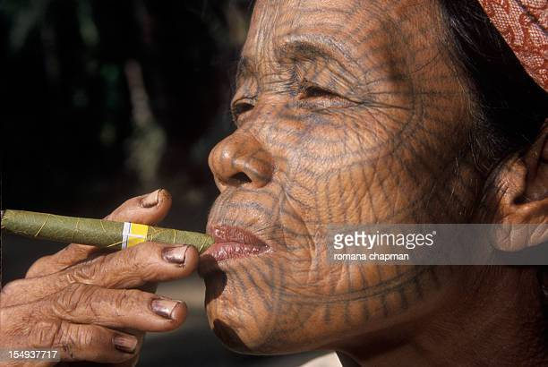 Profile of Tribal woman with tattooed face
