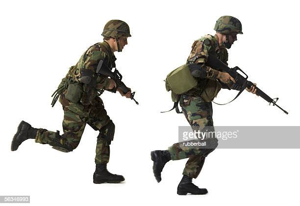Profile of two soldiers running with their guns