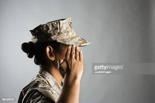 profile of united states marine saluting - army soldier stock photos and pictures