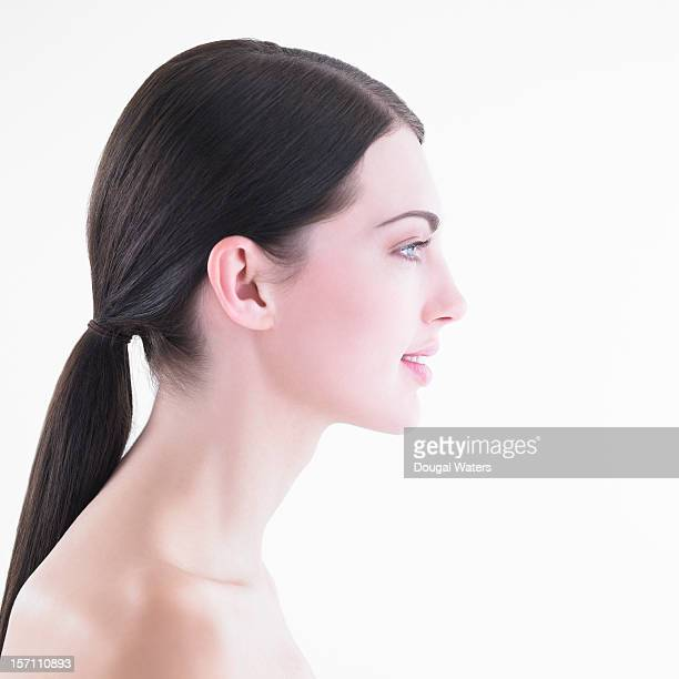 Profile of woman against white background.