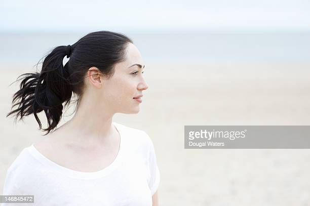 profile of woman at beach. - ponytail stock pictures, royalty-free photos & images
