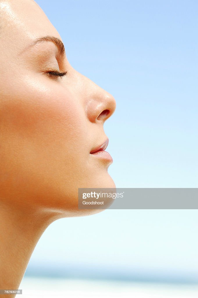 Profile of woman basking in the day : Stock Photo