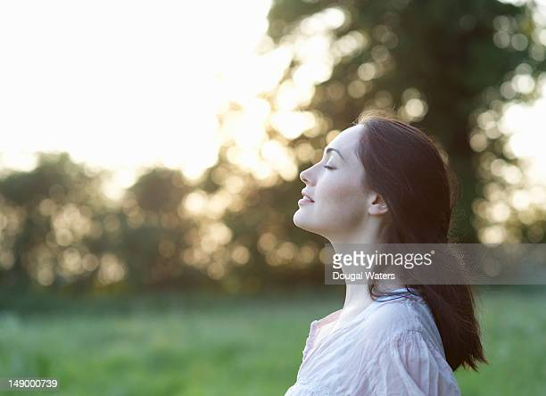 Profile of woman in countryside.