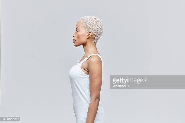 Profile of woman in front of grey background