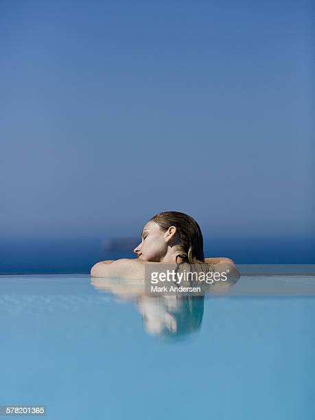Profile of woman in pool with eyes closed
