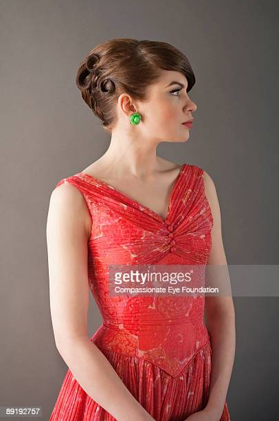 """profile of woman in red dress - """"compassionate eye"""" stock pictures, royalty-free photos & images"""