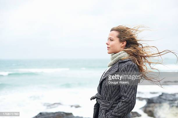 profile of woman on coastline. - hands in pockets stock pictures, royalty-free photos & images