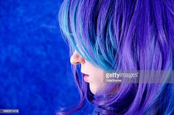 Profile of woman with blue/purple hair over upper face.