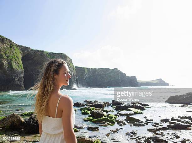Profile of woman with eyes closed at beach
