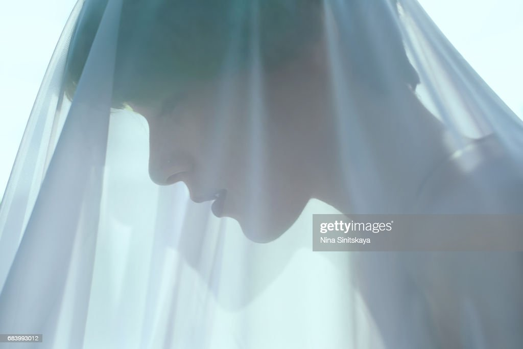 Profile of woman with green hair under blue veil : Stock Photo