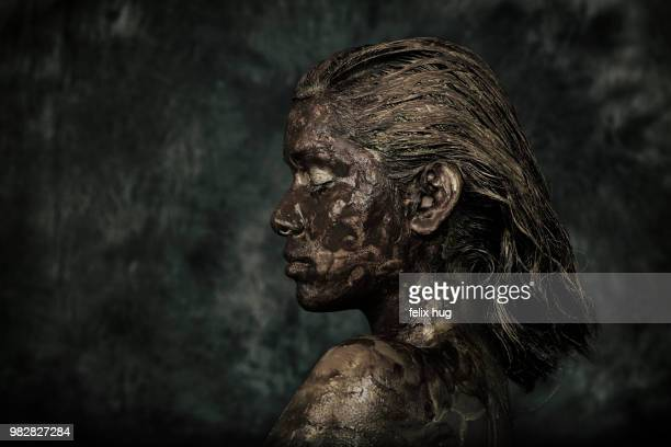 profile of woman with mud on body and face - body paint stock pictures, royalty-free photos & images
